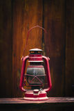 Still life of old hurricane lamp. On wooden background Royalty Free Stock Photography