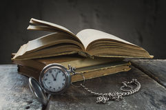 Still life with old pocket watch and books. Stock Photography