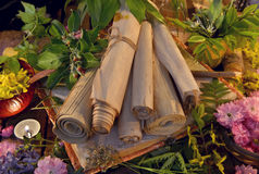 Still life with old scrolls, candles and healing herbs royalty free stock photography