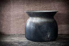 Still life Old steaming pot on wooden Stock Photo
