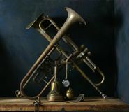Still-life with old Trumpets. On a dark blue background royalty free stock photo