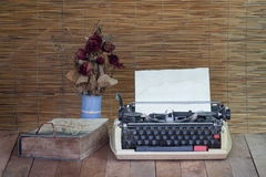 Still life with old typewriter ,book ,eyeglasses with dry rose Stock Photos