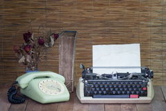 Still life with old typewriter telephone book with dry rose Stock Photos