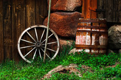 Still-life with an old wheel and barrel Royalty Free Stock Images