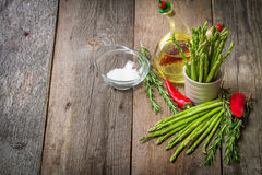 Still life with olive oil asparagus, avocado, pepper and rosemar Royalty Free Stock Photos