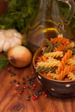 Still life with olive oil, Fusilli Pasta, herbs and spices Stock Photography