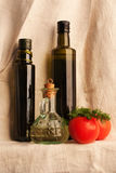 Still Life with olive oil retro bottles on canvas Royalty Free Stock Photo