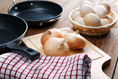 Still-life with onion pans and  eggs Royalty Free Stock Photography
