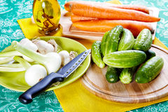 Still-life with onions cucumbers  and carrots Royalty Free Stock Photo