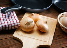 Still life with onions and quail eggs Royalty Free Stock Photography