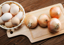 Still life with onions and quail eggs Stock Images