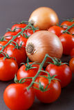 Still-life with onions and tomatoes Royalty Free Stock Photos