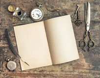 Still life with open book and antique writing tools Stock Images