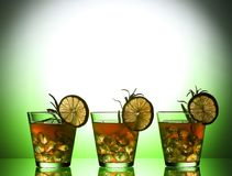 Still life with colorful bright cocktails on glass, decorated with rosemary and lime Stock Image