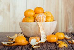 Still life of orange fruit in bowl on old wood background. Royalty Free Stock Photography