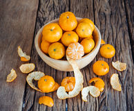 Still life of orange fruit in bowl on old wood background. Royalty Free Stock Image