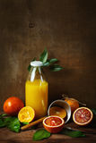 Still life with orange fruit and juice Royalty Free Stock Image
