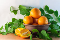 Still life of oranges in a clay bowl Royalty Free Stock Photo