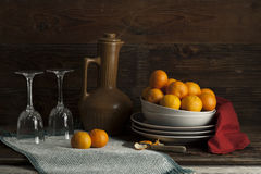 Still life of oranges and glasses. Royalty Free Stock Photo