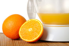 Still life with oranges and a juice extractor Stock Photo