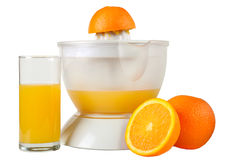 Still life with oranges and juice. Oranges, juice extractor and glass of juice isolated on white royalty free stock image