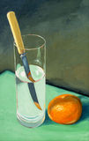 A still life painting. With a tangerine and a knife Royalty Free Stock Image