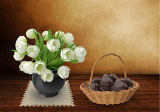 Still life painting: white tulips and candy.3D rendering. Still life: on the surface of the wooden table stands on a napkin ceramic vase with white tulips Stock Photography