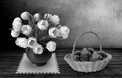 Still life painting: white tulips and candy.3D rendering. Still life: on the surface of the wooden table stands on a napkin ceramic vase with white tulips Royalty Free Stock Photography
