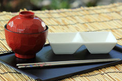 STILL LIFE-a pair of chopsticks and a cup Royalty Free Stock Image