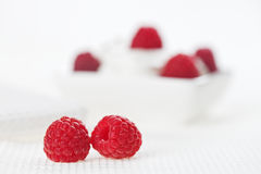 Still life with pair of raspberry on white linen Royalty Free Stock Image