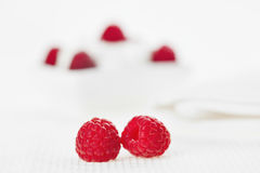 Still life with pair of raspberry on white linen Royalty Free Stock Photo