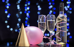Still life party scene of balloons,hats and champagne. Royalty Free Stock Photo