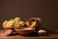 Still life with pasta and ceramic ware Stock Photo