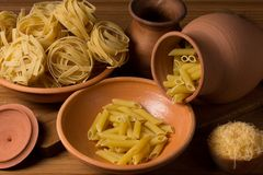 Still life with pasta and ceramic ware Royalty Free Stock Photography