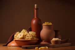 Still life with pasta and ceramic ware Stock Photography