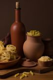 Still life with pasta and ceramic ware Stock Image