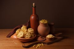 Still life with pasta and ceramic ware Royalty Free Stock Photo