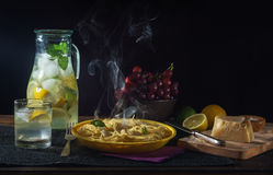 Still life with pasta on dark background Royalty Free Stock Images