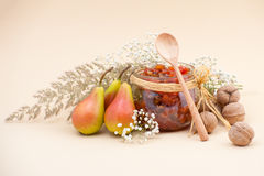 Still life with pear jam, pears, dried herbs and walnuts on a li Royalty Free Stock Image