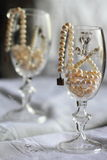 Still life: pearls in a glass. Jewelry from pearls in a glass with indistinct reflection in a mirror Royalty Free Stock Photo