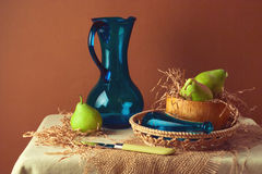 Still life with pears and blue jug Royalty Free Stock Photo