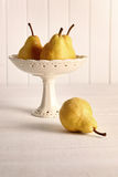 Still life of pears in fruit bowl royalty free stock photo