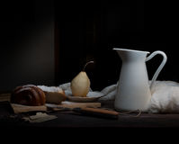 Still life. pears and a jug of milk on  dark background. old painting, vintage. Royalty Free Stock Image