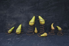 Still-life with pears and old rusty springs Royalty Free Stock Photography