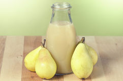 Still life of pears and pear juice Royalty Free Stock Photos