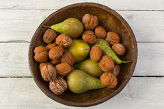 Still life with pears and walnuts Royalty Free Stock Image