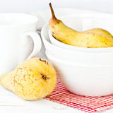 Still life with pears and white crockery Royalty Free Stock Image