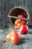Still Life with Pears on the wooden table Stock Images