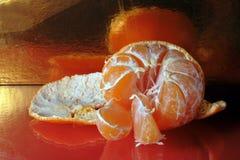 Still-life of peeled mandarin Stock Photos