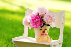 Still life with peonies on the lawn Royalty Free Stock Photography